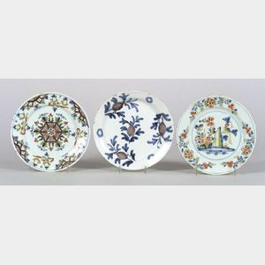 Three Delftware Polychrome Decorated Plates