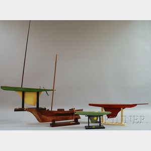 Four Small Wooden Sailboat Models