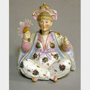Continental Porcelain Nodder Figure of a Stylized Asian Woman with a Fan.