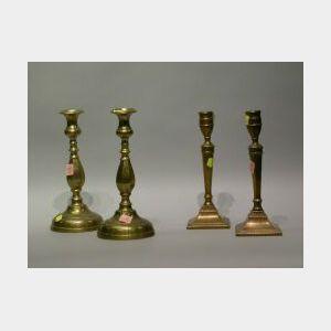 Four Brass Candlesticks.
