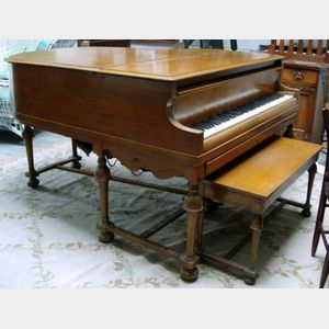 Small Player Piano with Veneered Case, bench and listing of songs.