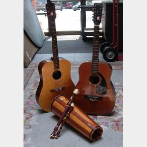 Japanese Aria Twelve-String Guitar, an Edmond Six-String Guitar, Two Aulos Recorders, and a Bongo Drum.