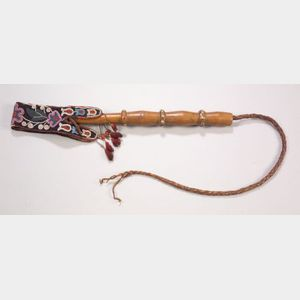 Northern Plains Carved Wood Quirt with Beaded Cloth Strap