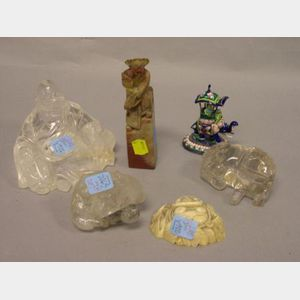 Three Chinese Carved Rock Crystal Figures, an Enamel Elephant and Rider, a Carved Hardstone Seal, and an Ivory Fragment.