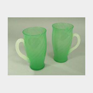 Pair of Steuben-type Green Jade and Clambroth Art Glass Mugs.