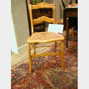 Set of Six Classical Caned Birds-eye and Tiger Maple Side Chairs.