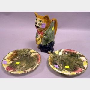 Pair of Majolica Leaf and Fern Decorated Plates and a Cat Toby Jug.