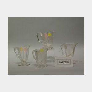 Twenty Assorted Colorless Pressed Pattern Glass Creamers.
