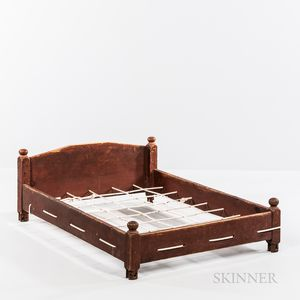 Red-painted Trundle Bed