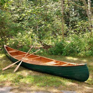 Arthur E. Levenseller 20-foot Canoe with Two Canoe Paddles.