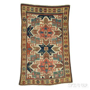 "Sold for: $35,670 - ""Star"" Kazak Rug"