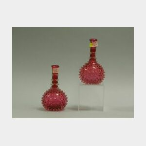 Pair of Cranberry Hobnail Glass Barber Bottles.