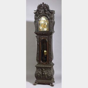 Sold for: $22,325 - Fine Renaissance Revival Carved and Ebonized Oak Cased Chiming Tall Clock