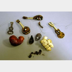 Four Miniature Tortoiseshell Veneered Musical Instruments and Two Meerschaum Pipes.