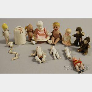 Twelve Miniature Bisque Dolls Including Kewpie