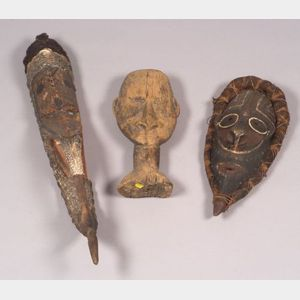 Three Carved Wood New Guinea Masks