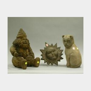 Carved Wooden Cat, Sun, and St. Nick Figures.