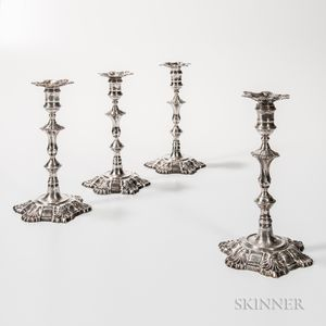 Four George II Sterling Silver Candlesticks