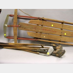 Flexible Flyer Sled and Ten Golf Clubs.
