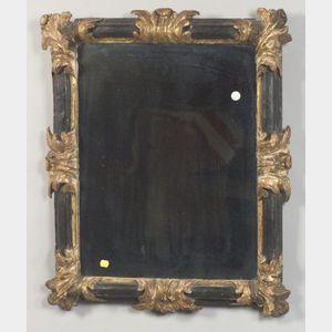 Continental Ebonized and Parcel-gilt Mirror