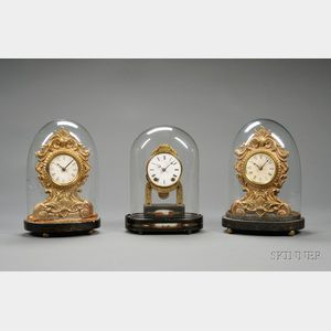 Group of Three Miniature Clocks Under Glass Domes