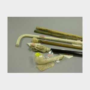 Two Ivory Heinz Presentation Canes and Three Assorted Crops.