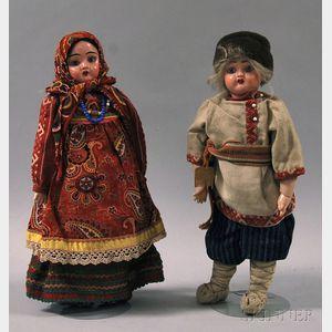 Two Papier-mache Dolls