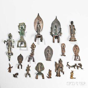 Eighteen Mostly Buddhist Archaic Gilt-bronze and Bronze Miniature Items