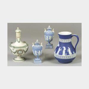 Wedgwood Dark Blue Jasper Dip Jug, a Pair of Small Light Blue Jasper Dip Lidded Urns and a Lidded Three-Color Bottle.