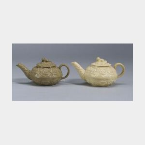 Two Wedgwood Arabesque Molded Teapots and Covers