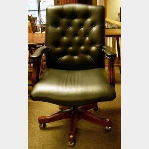 Georgian-style Tufted Black Leather Upholstered Swivel Desk Armchair.