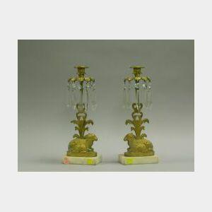 Pair of Brass Recumbent Lamb Girandoles.