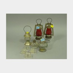 Four Miniature Lanterns, a Set of Four Glass Salts, and a Glass Salt Shaker.