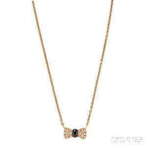 18kt Gold, Onyx, and Diamond Bow Necklace, Van Cleef & Arpels