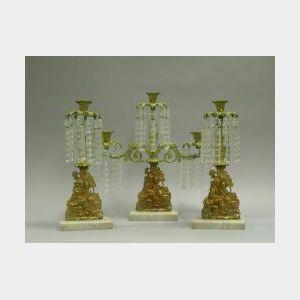 Three-Piece Brass and Bronze Girandole Set.