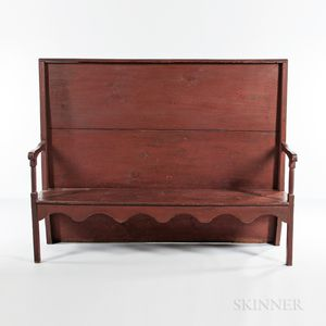 Red-painted Settle Bench