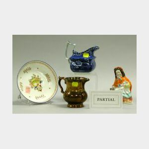 Fourteen English Pottery Figures, Pitchers, Cups, and Saucers, Etc.