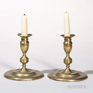 Pair of Early Round-base Brass Candlesticks