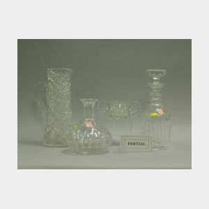 Eight Colorless Cut and Pressed Glass Table Items.