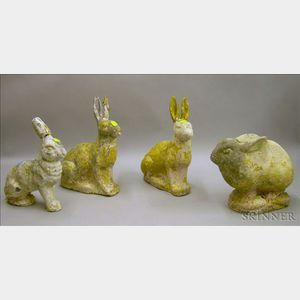 Group of Four Cast Stone Rabbits