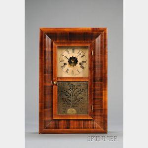 Miniature Mahogany Ogee Clock by Waterbury Clock Company