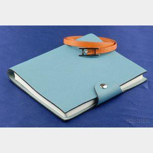 Orange Leather Bracelet and Blue Notebook, Hermes
