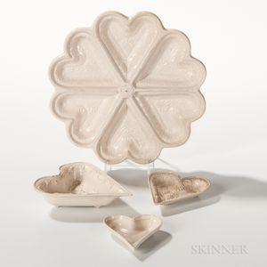 Four Molded Staffordshire Salt-glazed Stoneware Heart-form Pastry Molds