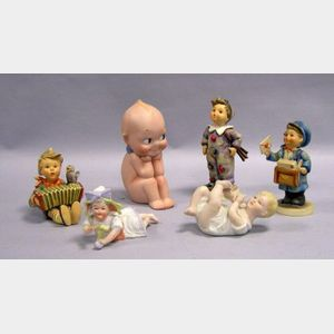 Three Ceramic Hummel Figures, Two Bisque Babies, and a Rose ONeall Kewpie.