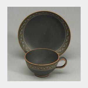 Wedgwood Encaustic Decorated Black Basalt Teacup and Saucer