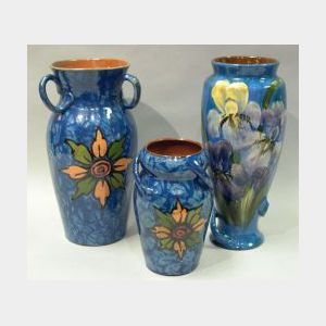 Two Royal Torquay Floral Marbled Three-Handled Vases and a Lemon & Crute Iris Vase.