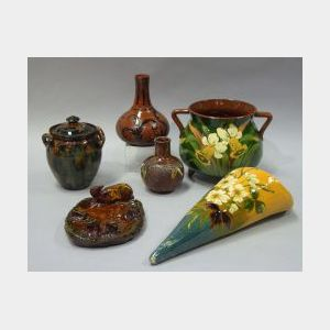 Longpark Daffodil Decorated Footed Pot and Rustic Rabbit Figural Cigar Ashtray, an Early Aller Vale Kerswell Daisy Pot, Scrolled Bottle