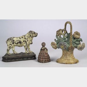 Three Painted Cast Iron Doorstops and a Brass School Bell with Wooden Handle
