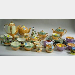 Four Japanese Iridescent Glazed Porcelain Partial Demitasse, Tea, and Luncheon Sets