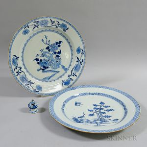 Two Blue and White Earthenware Dishes and a Bird Feeder